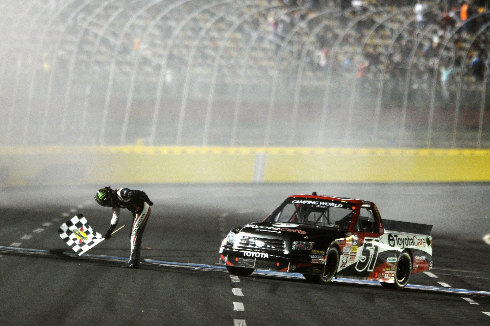 2013-Charlotte-Trucks-Kyle-Busch-With-Checkered-Flag