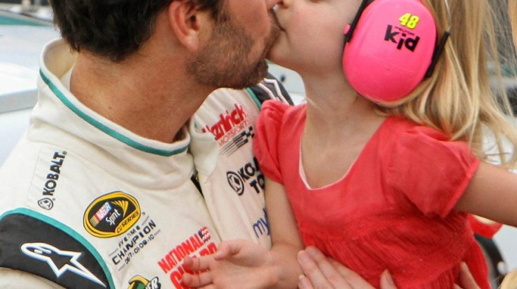 Fourth place finisher Jimmie Johnson, driver of the NASCAR Sprint Cup #48 Lowe's Emerald Green Chevrolet SS gives his daughter, Genevieve, a kiss at Darlington Raceway before the Bojangles' 500 in Darlington, South Carolina May 11, 2013. Johnson continues to lead the NASCAR Sprint Cup Series (NSCS) standings.(Photo by Alan Marler for Chevrolet)