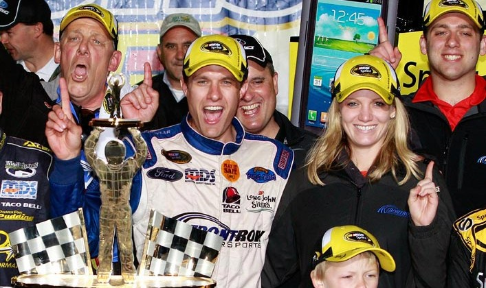 David Ragan, driver of the #34 Farm Rich Ford, celebrates in victory lane after winning the NASCAR Sprint Cup Series Aaron's 499 at Talladega Superspeedway on May 5, 2013 in Talladega, Alabama. (Credit: Jerry Markland/Getty Images)