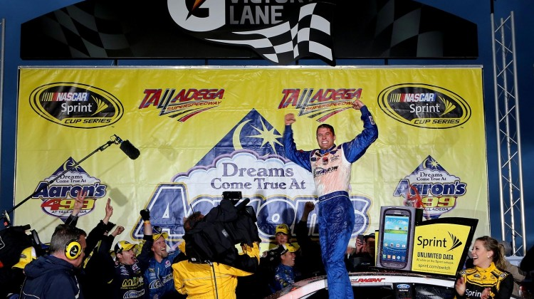 David Ragan, driver of the #34 Farm Rich Ford, celebrates in Victory Lane with wife Jacquelyn Butler Ragan after winning the NASCAR Sprint Cup Series Aaron's 499 at Talladega Superspeedway on May 5, 2013 in Talladega, Alabama. (Credit: Sean Gardner/Getty Images)