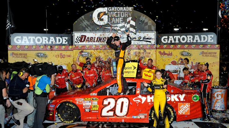 Matt Kenseth, driver of the #20 The Home Depot / Husky Toyota, celebrates with his crew in victory lane after winning the NASCAR Sprint Cup Series Bojangles' Southern 500 at Darlington Raceway on May 11, 2013 in Darlington, South Carolina. (Photo by Rainier Ehrhardt/Getty Images)