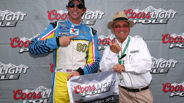Travis Pastrana, driver of the #60 Roush Fenway Racing Ford, poses with his pole award along with team owner Jack Roush (R) after qualifying firist for the NASCAR Nationwide Series Aaron's 312 at Talladega Superspeedway on May 3, 2013 in Talladega, Alabama. (Credit: Tom Pennington/Getty Images)