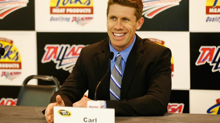 Carl Edwards, driver of the #99 Fastenal Ford, speaks with the media after he was awarded the pole award during qualifying for the NASCAR Sprint Cup Series Aaron's 499 at Talladega Superspeedway on May 4, 2013 in Talladega, Alabama. (Credit: Jared Wickerham/Getty Images)