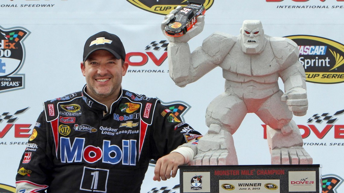 Tony Stewart, driver of the NASCAR Sprint Cup #14 Code 3 Associates/Mobil 1 Chevrolet SS with the Monster Mile Champion trophy after winning the FedEx 400 Benefiting Autism Speaks at Dover International Speedway Sunday, June 2, 2103 in Dover, Delaware. (Photo by Alan Marler for Chevrolet)