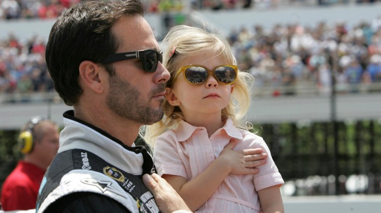 Jimmie Johnson, driver of the NASCAR Sprint Cup #48 Lowe's Kobalt Tools Chevrolet SS and his daughter, Genevieve Marie, stand during the national anthem before winning the Party In The Poconos 400 Sunday, June 9, 2013 at the Pocono Raceway in Long Pond, Pennsylvania. (Photo by Alan Marler for Chevrolet)