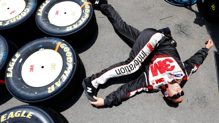 Greg Biffle, driver of the #16 3M Ford, stretches prior to the NASCAR Sprint Cup Series Party in the Poconos 400 at Pocono Raceway on June 9, 2013 in Long Pond, Pennsylvania. (Credit: Jared Wickerham/Getty Images)