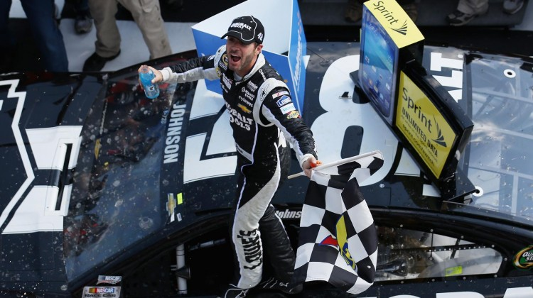 Jimmie Johnson, driver of the #48 Lowe's/Kobalt Tools Chevrolet, celebrates in Victory Lane after winning the NASCAR Sprint Cup Series Party in the Poconos 400 at Pocono Raceway on June 9, 2013 in Long Pond, Pennsylvania. (Credit: Nick Laham/Getty Images)
