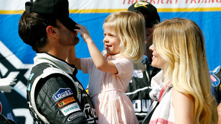 Jimmie Johnson, driver of the #48 Lowe's/Kobalt Tools Chevrolet, celebrates in Victory Lane with his wife Chandra and daughter Genevieve Marie after winning the NASCAR Sprint Cup Series Party in the Poconos 400 at Pocono Raceway on June 9, 2013 in Long Pond, Pennsylvania. (Credit: Jared Wickerham/Getty Images)