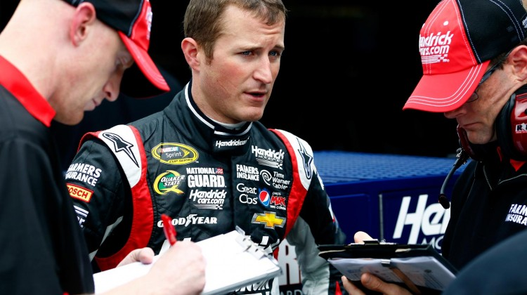 Kasey Kahne, driver of the #5 Hendrickcars.com Chevrolet, talks to crew members during practice for the NASCAR Sprint Cup Series Party in the Poconos 400 at Pocono Raceway on June 8, 2013 in Long Pond, Pennsylvania. (Credit: Jeff Zelevansky/Getty Images)