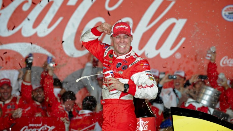 Kevin Harvick, driver of the #29 Budweiser Folds of Honor Chevrolet, celebrates in Victory Lane after winning the NASCAR Sprint Cup Series Coca-Cola 600 at Charlotte Motor Speedway on May 26, 2013 in Concord, North Carolina. (Photo by Jared C. Tilton/Getty Images)