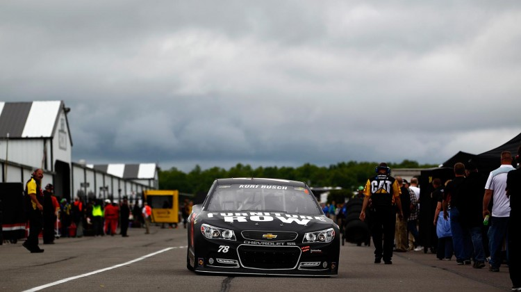 Kurt Busch, driver of the #78 Furniture Row Racing/Denver Mattress Chevrolet, drives through the garage during practice for the NASCAR Sprint Cup Series Party in the Poconos 400 at Pocono Raceway on June 8, 2013 in Long Pond, Pennsylvania. (Credit: Jeff Zelevansky/Getty Images)