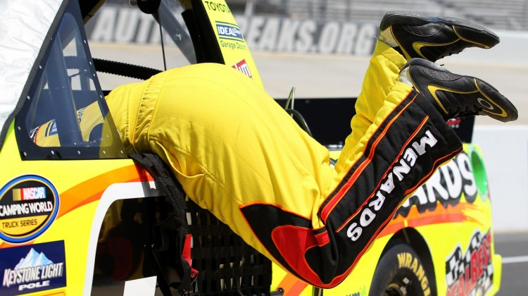 Matt Crafton, driver of the #88 Goof Off/Menards Toyota, reaches into his truck during practice for the NASCAR Camping World Truck Series Lucas Oil 200 at Dover International Speedway on May 30, 2013 in Dover, Delaware. (Photo by Todd Warshaw/NASCAR via Getty Images)