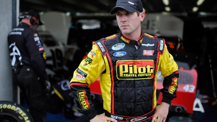 Michael Annett, driver of the #43 EFS Ford, stands in the garage during practice for the NASCAR Nationwide Series History 300 at Charlotte Motor Speedway on May 23, 2013 in Concord, North Carolina. (Photo by Rainier Ehrhardt/NASCAR via Getty Images)