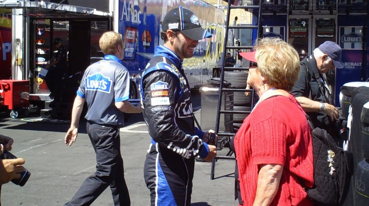 Jimmie Johnson chats with a woman at Sonoma Raceway on Friday, June 21, 2013. (Credit: The Fast and the Fabulous)