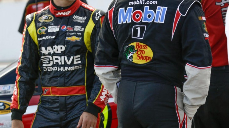 Jeff Gordon, driver of the NASCAR Sprint Cup #24 Drive To End Hunger Chevrolet SS, left, talks with Tony Stewart, driver of the NASCAR Sprint Cup #14 Chevrolet SS, center, during qualifying races Friday, July 12, 2013 at New Hampshire Motor Speedway for Sunday's Camping World RV Sales 301 in Loudon, New Hampshire. Gordon captured the fifth pole position, Stewart the sixteenth spot. (Harold Hinson for Chevrolet)