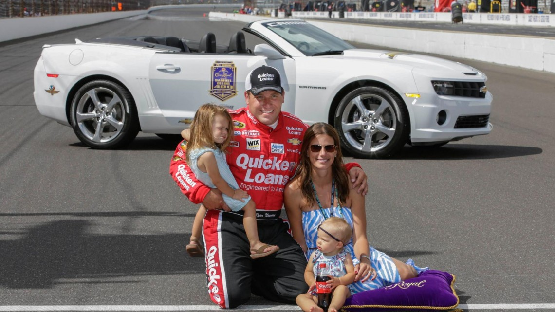 Ryan Newman, driver of the NASCAR Sprint Cup #39 Quicken Loans/The Smurfs Chevrolet SS won the Brickyard 400 at Indianapolis Motor Speedway Sunday, July 28, 2013 in Indianapolis, Indiana. He's shown with his wife, Krissie, and his children, Brooklyn Sage, left, and Ashlyn Olivia, right. (Harold Hinson for Chevrolet)