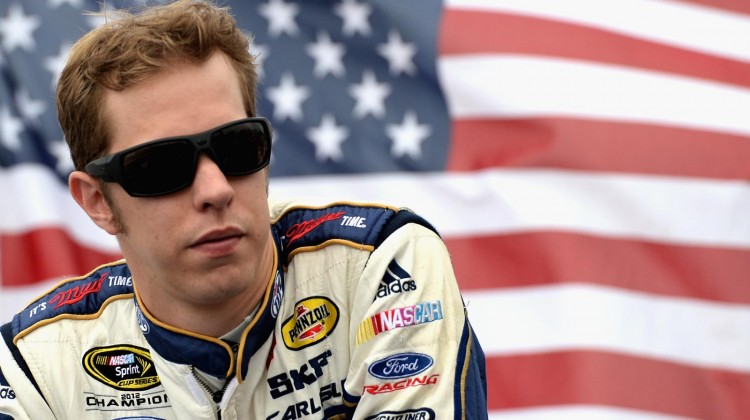 Brad Keselowski, driver of the #2 Miller Lite Ford, looks on during driver introductions prior to the NASCAR Sprint Cup Series Camping World RV Sales 301 at New Hampshire Motor Speedway on July 14, 2013 in Loudon, New Hampshire. (Credit: Patrick Smith/Getty Images)