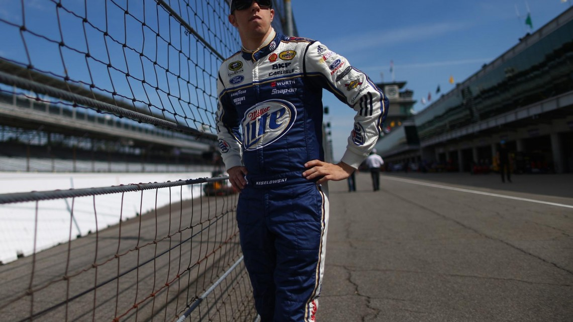 Brad Keselowski, driver of the #2 Miller Lite Ford, looks on from the garage area during practice for the NASCAR Sprint Cup Series Samuel Deeds 400 At The Brickyard at Indianapolis Motor Speedway on July 26, 2013 in Indianapolis, Indiana. (Credit: Chris Graythen/Getty Images)