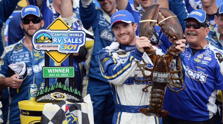 Brian Vickers, driver of the #55 Aaron's Dream Machine Toyota, celebrates in Victory Lane after winning the NASCAR Sprint Cup Series Camping World RV Sales 301 at New Hampshire Motor Speedway on July 14, 2013 in Loudon, New Hampshire. (Credit: Patrick Smith/Getty Images)