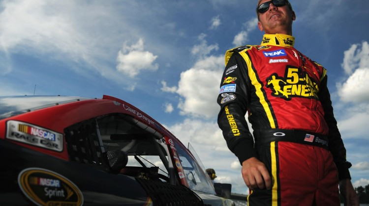 Clint Bowyer, driver of the #15 5-hour ENERGY Toyota, climbs out of his car after qualifying for the NASCAR Sprint Cup Series Camping World RV Sales 301 at New Hampshire Motor Speedway on July 12, 2013 in Loudon, New Hampshire. (Photo by Jared C. Tilton/Getty Images)