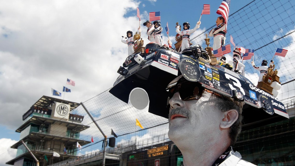 A Dale Earnhardt fan poses on the grid during qualifying for the NASCAR Nationwide Series Indiana 250 at Indianapolis Motor Speedway on July 27, 2013 in Indianapolis, Indiana. (Credit: Matt Sullivan/Getty Images)