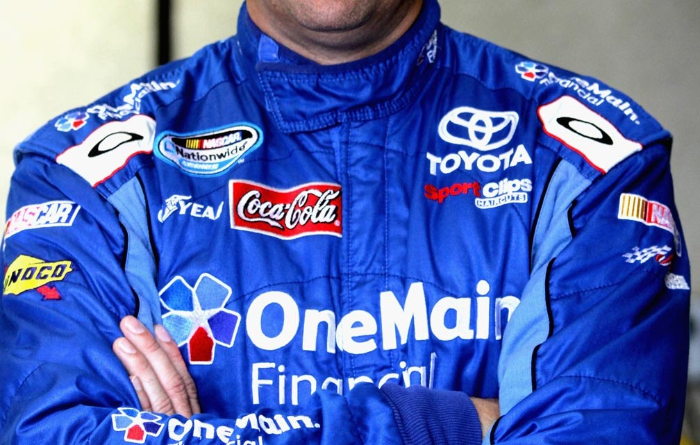 Elliott Sadler, driver of the #11 OneMain Financial Toyota, looks on in the garage area during practice for the NASCAR Nationwide Series Indiana 250 at Indianapolis Motor Speedway on July 26, 2013 in Indianapolis, Indiana. (Credit: Jerry Markland/Getty Images)