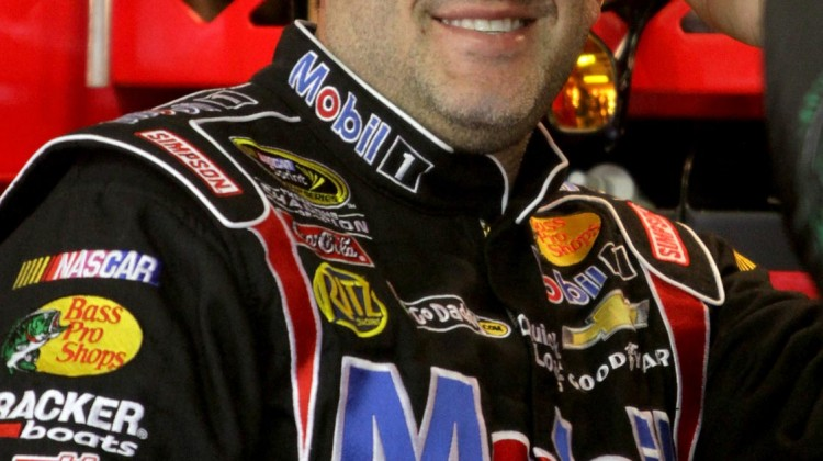 Tony Stewart, driver of the #14 Mobil 1 Chevrolet, stands in the garage during practice for the NASCAR Sprint Cup Series Camping World RV Sales 301 at New Hampshire Motor Speedway on July 12, 2013 in Loudon, New Hampshire. (Photo by Jerry Markland/Getty Images)