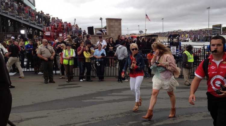 Clint Bowyer's girlfriend, Lorra Podsiadlo (left) and Matt Kenseth's wife, Katie, walk to the garage after the race at Sonoma Raceway on Sunday, July 23, 2013. (photo credit: The Fast and the Fabulous)