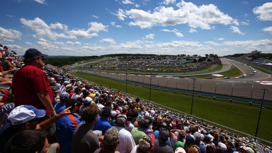 View of cars racing the NASCAR Sprint Cup Series Cheez-It 355 at The Glen at Watkins Glen International on August 11, 2013 in Watkins Glen, New York. (Credit: Jonathan Ferrey/NASCAR via Getty Images)