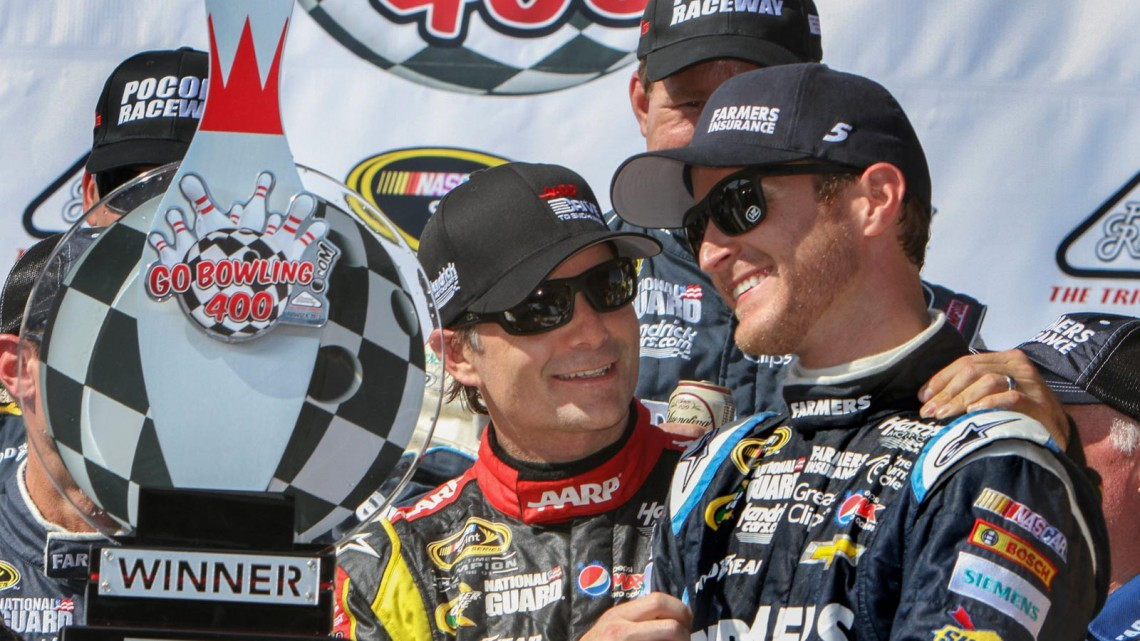 Kasey Kahne, driver of the NASCAR Sprint Cup #5 Farmers Insurance Chevrolet SS, right, is congratulated for his win by Jeff Gordon, driver of the NASCAR Sprint Cup #24 Drive To End Hunger Chevrolet SS, left, Sunday, August 4, 2013 at Pocono Raceway in the GoBowling 400 in Pocono, Pennsylvania. Gordon finished second. (Alan Marler for Chevrolet)