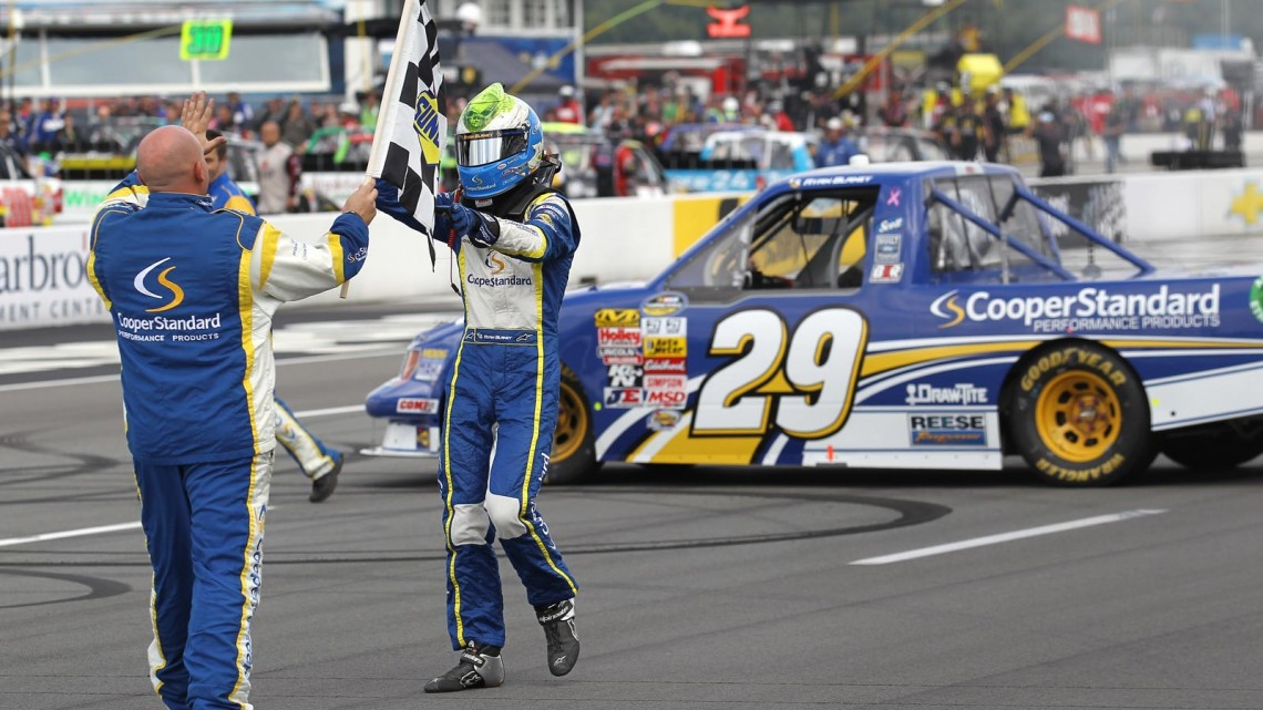 Ryan Blaney, driver of the #29 Cooper Standard Ford, celebrates with his crew after winning the NASCAR Camping World Truck Series Pocono Mountains 125 at Pocono Raceway on August 3, 2013 in Long Pond, Pennsylvania. (Photo by Todd Warshaw/NASCAR via Getty Images)