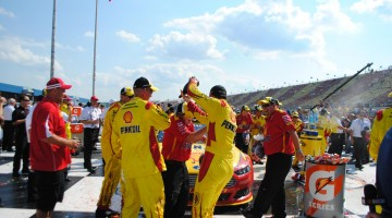 The No. 22 Shell-Pennzoil team celebrate with Joey Logano in Victory Lane at Michigan International Speedway in Brookyln, MI (Credit: Heather Baker for The Fast and the Fabulous)