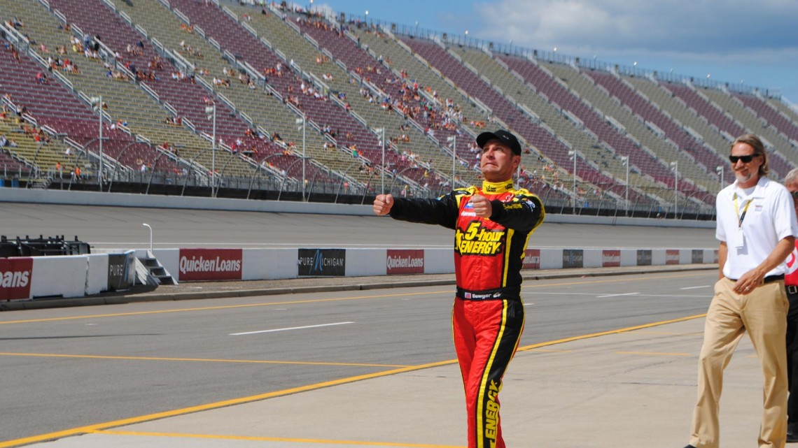 I have no idea what Clint Bowyer is doing in this photo but I love it. Michigan International Speedway in Brookyln, MI (Credit: Heather Baker for The Fast and the Fabulous)