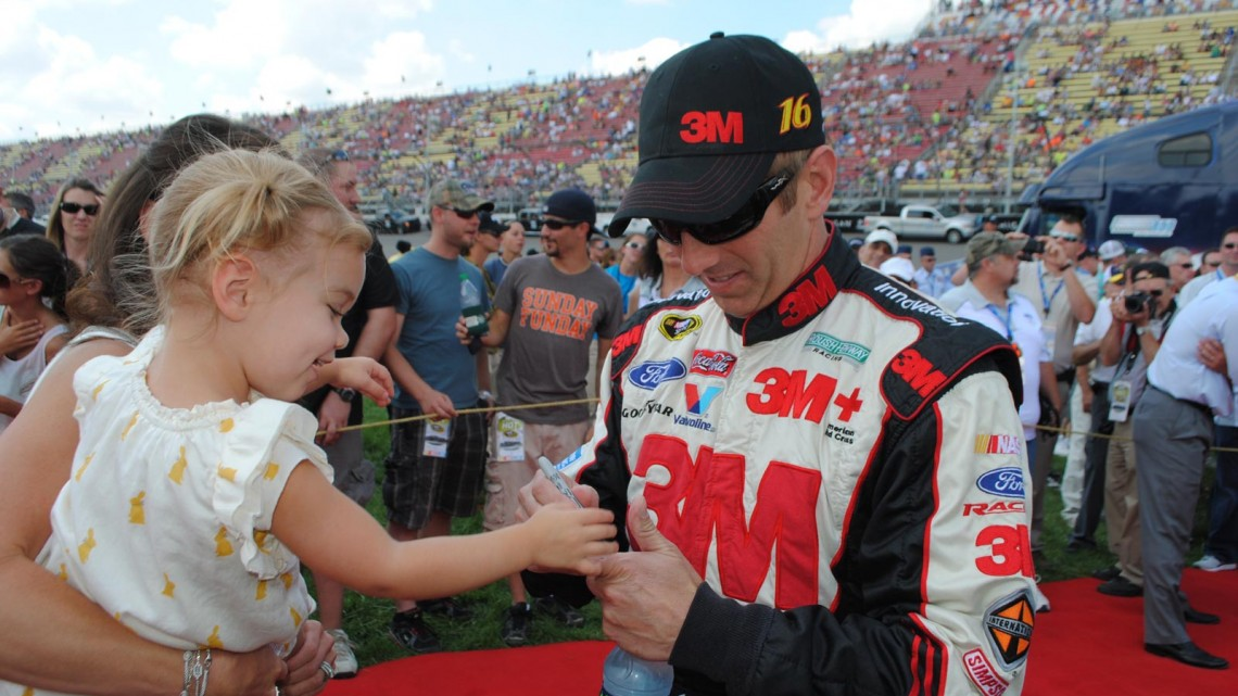 Greg Biffle plays with his daughter Emma at Michigan International Speedway in Brookyln, MI (Credit: Heather Baker for The Fast and the Fabulous)