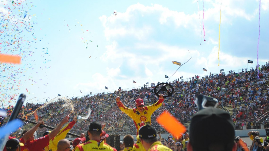 Joey Logano celebrates at Michigan International Speedway in Brookyln, MI (Credit: Heather Baker for The Fast and the Fabulous)