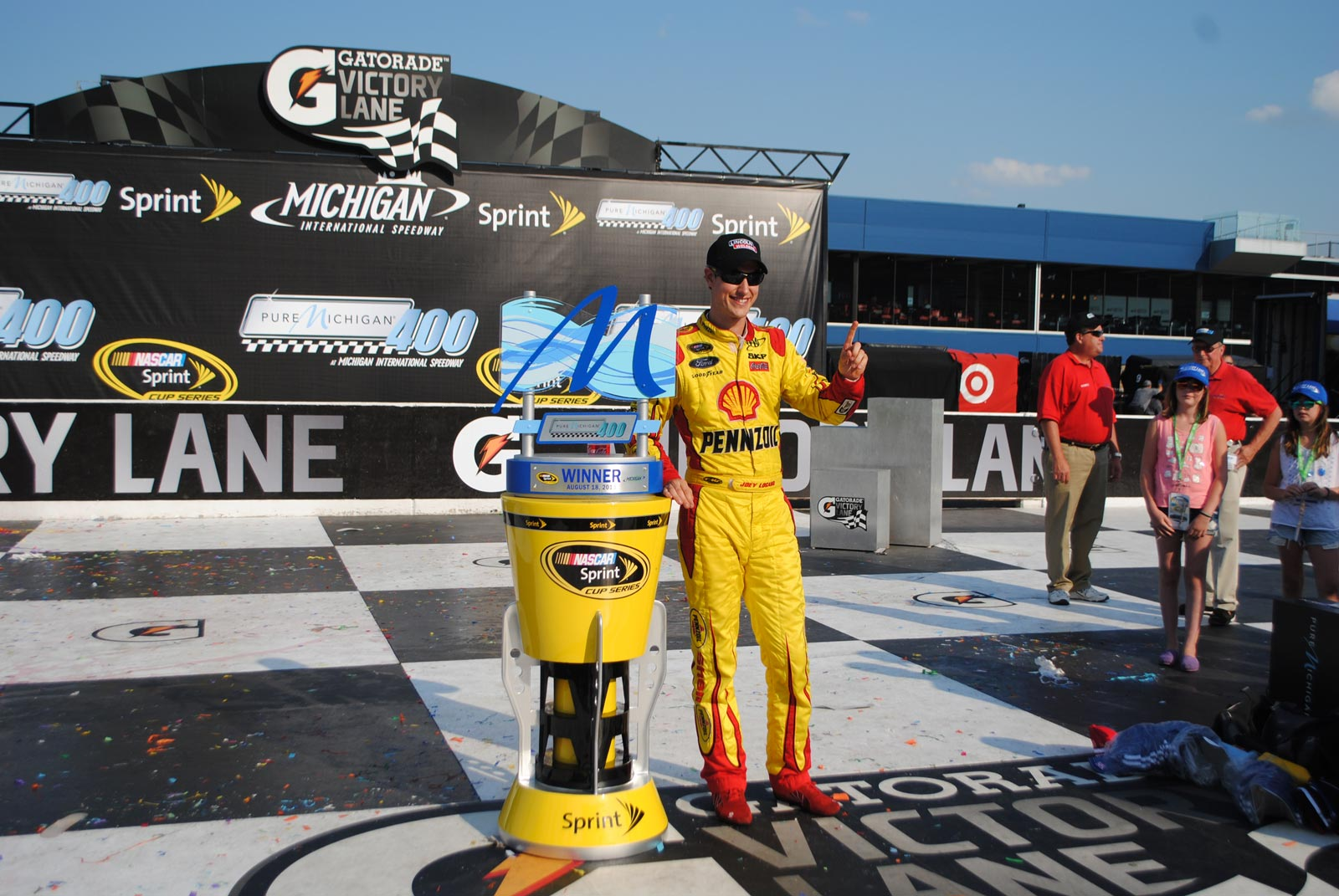 michigan-joey-logano-win-trophy