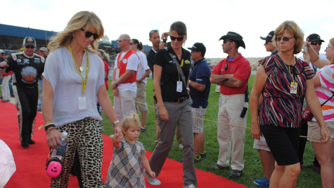 Katie Kenseth, wife of Matt Kenseth, walks with their daughter Grace at Michigan International Speedway in Brookyln, MI (Credit: Heather Baker for The Fast and the Fabulous)