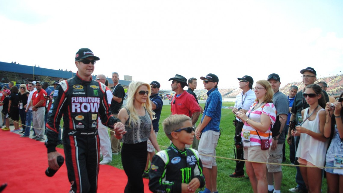 Kurt Busch walks with his girlfriend, Patricia Driscoll and her son, at Michigan International Speedway in Brookyln, MI (Credit: Heather Baker for The Fast and the Fabulous)
