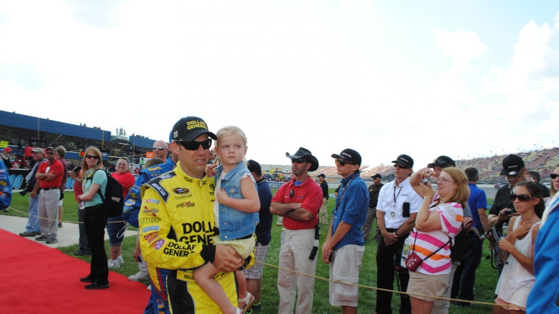 Matt Kenseth holds daughter Kaylin at Michigan International Speedway in Brookyln, MI (Credit: Heather Baker for The Fast and the Fabulous)