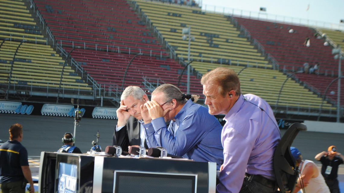 John Roberts, Kyle Petty and Kenny Wallace get ready to broadcast live on NASCAR Victory Lane at Michigan International Speedway in Brookyln, MI (Credit: Heather Baker for The Fast and the Fabulous)