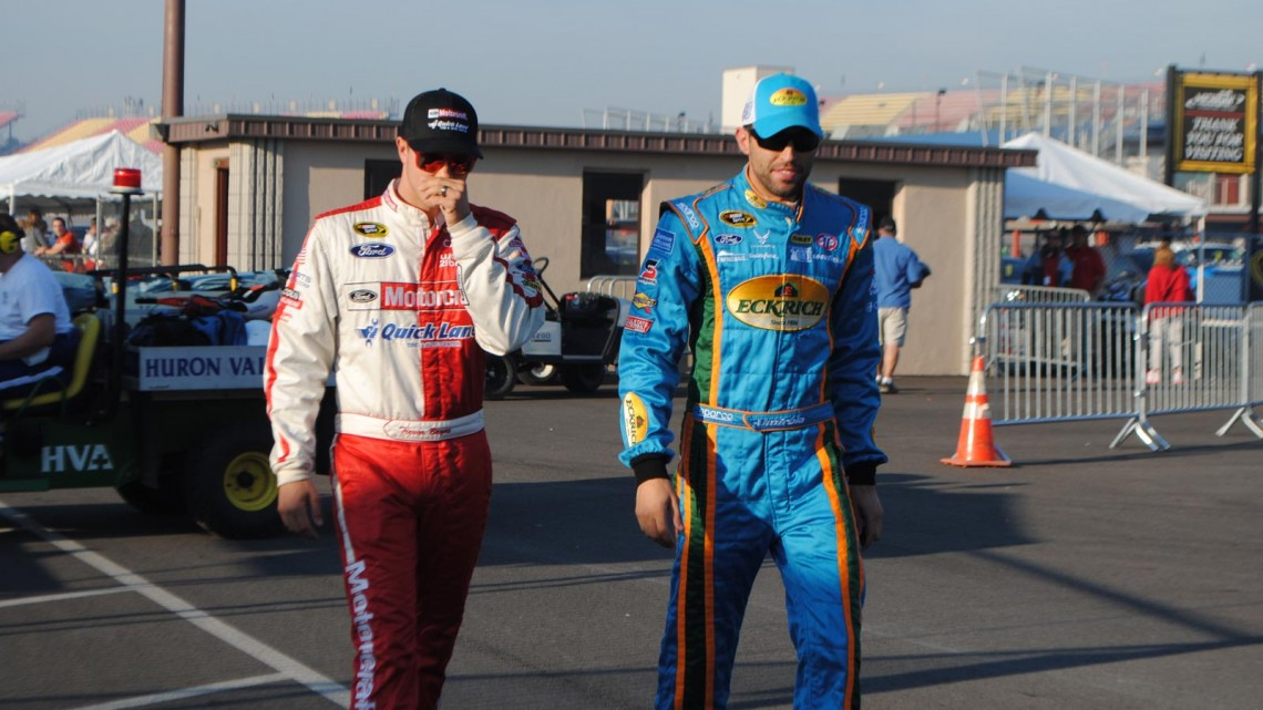 Trevor Bayne and Aric Almirola at Michigan International Speedway in Brookyln, MI (Credit: Heather Baker for The Fast and the Fabulous)