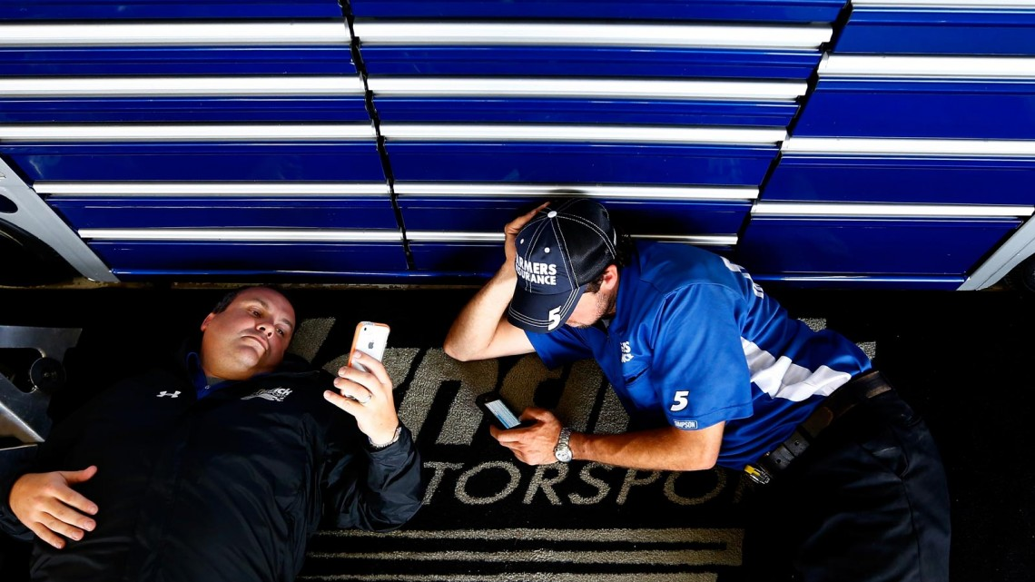 Crew members for Kasey Kahne, driver of the #5 Farmers Insurance Chevrolet, sit in the garage during a rain delay during practice for the NASCAR Sprint Cup Series Cheez-It 355 at Watkins Glen International on August 9, 2013 in Watkins Glen, New York. (Credit: Jared Wickerham/Getty Images)