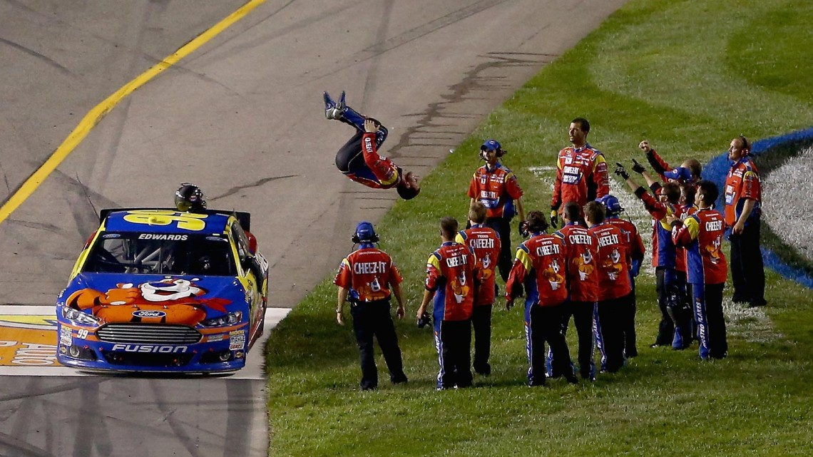 Carl Edwards, driver of the #99 Kellogg's / Cheez-It Ford, performs a flip off of his car to celebrate winning the NASCAR Sprint Cup Series 56th Annual Federated Auto Parts 400 at Richmond International Raceway on September 7, 2013 in Richmond, Virginia. (Credit: Streeter Lecka/Getty Images)