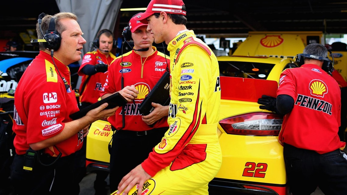(R-L) Joey Logano, driver of the #22 Shell Pennzoil Ford, talks with crew chief Todd Gordon in the garage area during practice for the NASCAR Sprint Cup Series Federated Auto Parts 400 at Richmond International Raceway on September 6, 2013 in Richmond, Virginia. (Credit: Justin Edmonds/Getty Images)