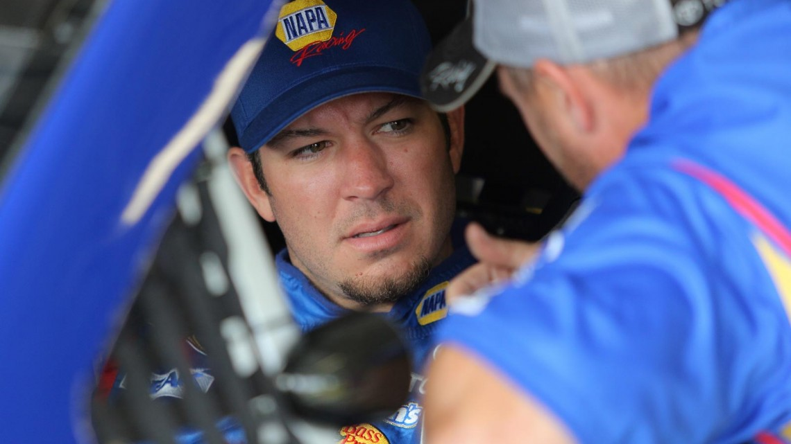 Martin Truex Jr., driver of the #56 NAPA Auto Parts Toyota, sits in his car in the garage area during practice for the NASCAR Sprint Cup Series 13th Annual Hollywood Casino 400 at Kansas Speedway on October 4, 2013 in Kansas City, Kansas. (Credit: NASCAR via Getty Images)