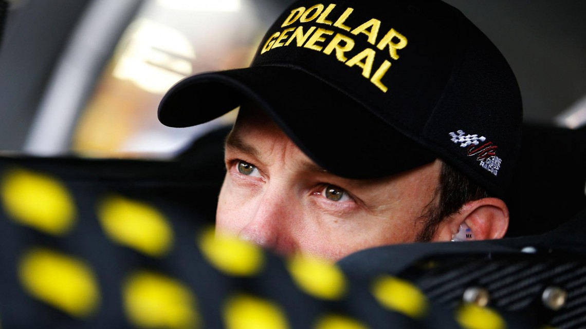 Matt Kenseth, driver of the #20 Dollar General Toyota, sits in his car in the garage during practice for the NASCAR Sprint Cup Series 13th Annual Hollywood Casino 400 at Kansas Speedway on October 4, 2013 in Kansas City, Kansas. (Credit: NASCAR via Getty Images)