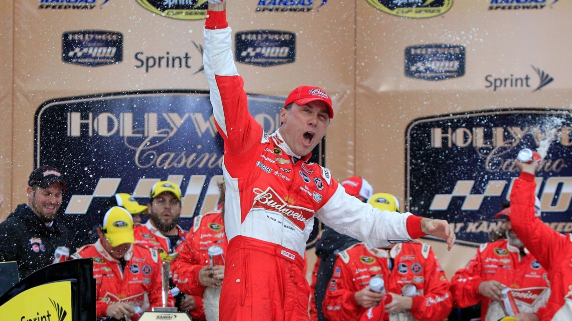 Kevin Harvick, driver of the #29 Budweiser Chevrolet, celebrates in Victory Lane after winning the NASCAR Sprint Cup Series 13th Annual Hollywood Casino 400 at Kansas Speedway on October 6, 2013 in Kansas City, Kansas. (Credit: Sean Gardner/Getty Images)