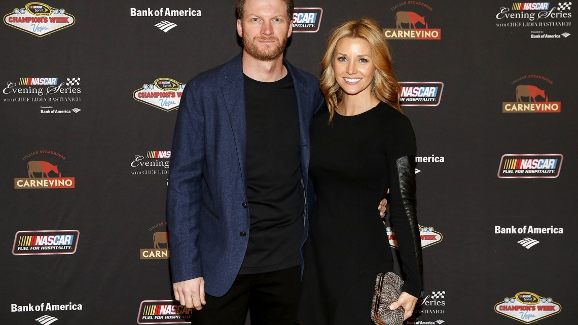 NASCAR Sprint Cup driver Dale Earnhardt Jr. and girlfriend Amy Reimann pose for a picture at the NASCAR Evening Series Presented by Bank of America at Carnevino at The Palazzo Las Vegas on December 4, 2013 in Las Vegas, Nevada. (Credit: NASCAR via Getty Images)