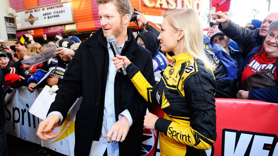 Miss Sprint Cup Brooke Werner interviews Sprint Cup Series driver Dale Earnhardt Jr. at a fanfest hosted by Las Vegas Motor Speedway on the Third Street Stage at the Fremont Street Experience on December 4, 2013 in Las Vegas, Nevada. (Credit: NASCAR via Getty Images)