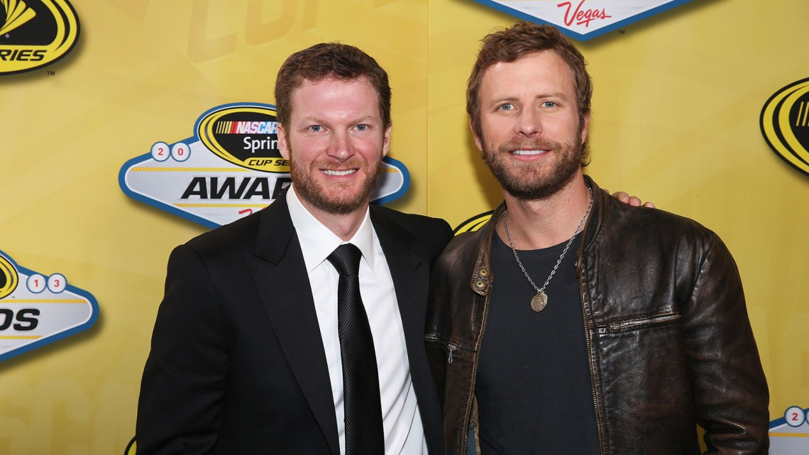 NASCAR Sprint Cup Series driver Dale Earnhardt Jr. and musician Dierks Bentley pose backstage during the 2013 NASCAR Sprint Cup Series Champion's Awards Ceremony at Wynn Las Vegas on December 6, 2013 in Las Vegas, Nevada.  (Credit: NASCAR via Jerry Markland/Getty Images)